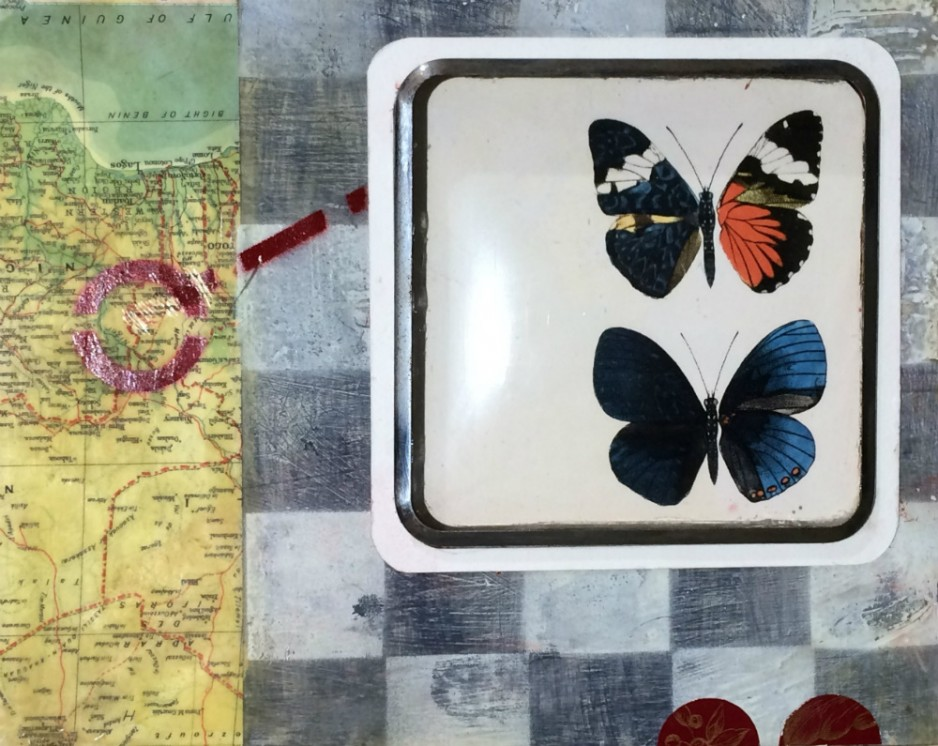 A map and magnifying glass and butterflies.