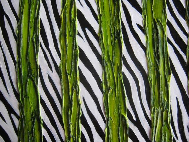 A black and white zebra print wall torn vertically four ways through the wall by green plant vines.